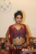 Ponytailed Indian wench strips and shows her round boobies