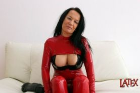 Latex Angel fucking her ass with huge dildo
