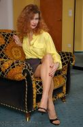 Mature redhead Claire in stockings