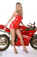 Blonde in red Sandra Sanchez stripping on a bike