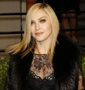 Madonna wearing black lace  fishnets at the Vanity Fair Oscar Party