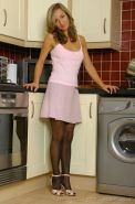 Melanie Walsh in a pink top and skirt