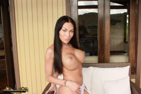 Busty tgirl Mia Isabella posing her hard shemale cock
