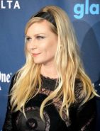 Kirsten Dunst wearing a partially see through little dress at the 24th Annual GL