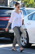 Minka Kelly showing pokies in white slightly transparent shirt while shopping in