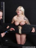 Busty blonde submissive Cherrys big tits in bondage and hotwaxing pain