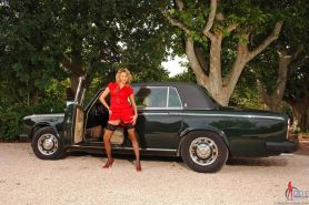 Rich blonde Zoe Fox in stockings on a hot car