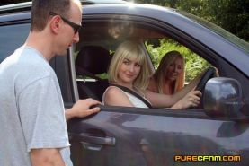 Girls pick up a hitch hiker and then force him to let them wank