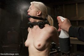 Ella Nova is bound in chains with clamps all over her naked body
