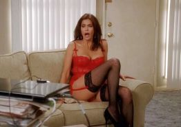 Teri Hatcher in red lingerie and black stockings and showing her tits