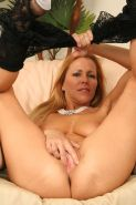 Experienced MILF Nicole Moore sits on top of a black cock and gi