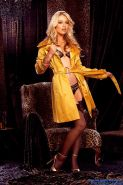 Kayden Kross opens up her yellow coat to reveal her sexy lingerie and stockings