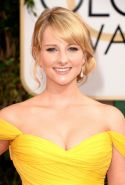 Busty Melissa Rauch wearing a yellow low cut dress at the 71st Annual Golden Glo