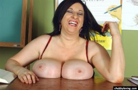 Busty fat teacher Kitty Lee gets nasty and toys in classroom