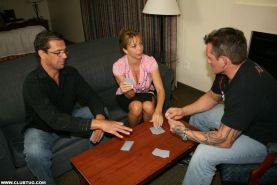 Amber Lynn Bach strokes big cock during a strip poker