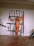 Bound female bdsm slave Crystel Lei tit tormented and bullwhipped in the dungeon
