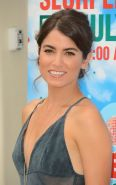 Nikki Reed braless showing huge cleavage in a low cut gray maxi dress at 7-Eleve