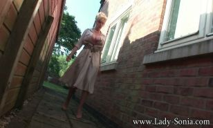 English milf Lady Sonia pees in an alleyway