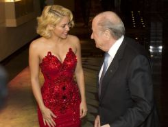 Shakira shows cleavage wearing strapless red dress at the FIFA Ballon d'Or Socce