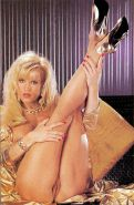 Amber Lynn showing her body in vintage porn pics
