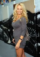 Pamela Anderson showing a lot of her legs in white shorts and mini skirt paparaz
