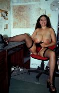 Plump office babe in sexy fishnets licking her huge natural tits