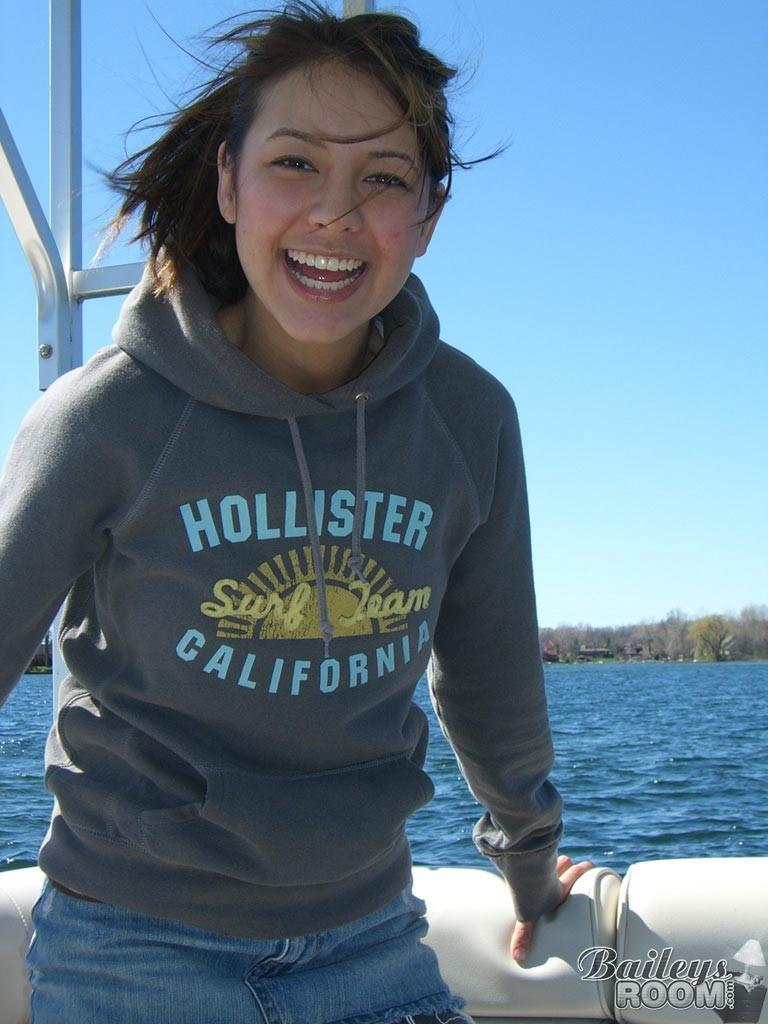 Real amateur teen girl sunbathing on a boat #78615708