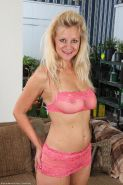 Toned busty blonde mature strips off her pink lingerie