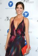 Tricia Helfer braless showing huge cleavage in a colorful partially see-through