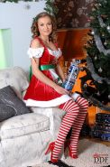 Lesperanza curly xmas brunette toys her pussy with a glass dildo
