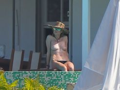 Heidi Klum caught topless wearing only black panties while on vacation in StBart