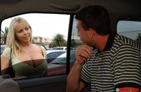 Huge titted hardcore MILF Amber Lynn gives head on the backseat