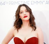 Kat Dennings busty wearing a strapless red dress at 64th Primetime Emmy Awards i