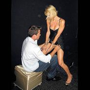 Paris Hilton performing lap dance for her boyfriend in public and showing tits a