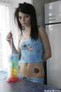 Skinny brunette emo chick undressing in the kitchen