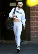 Miley Cyrus booty in white tights and belly top trying to hide from paparazzi ou