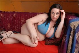 Full figured mature woman plays with inflatable sex toy
