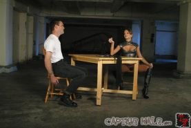 Nika Noire dominatrix in boots spanks and strapon bound slave