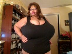 Norma Stitz flashing her enormous black juggs