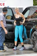Joanna Krupa braless wearing tiny black top and tights at a gas station in Miami