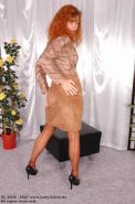 German redhead lady Claire displays her legs