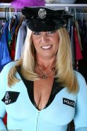 Naturally busty mature babe in cop outfit