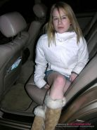 Babe posing in backseat of a cara about to get fucked silly in public