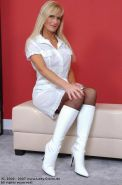 Lady Claire in black stockings and white boots