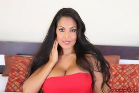 Nina Mercedez busts her big tits out of her red dress