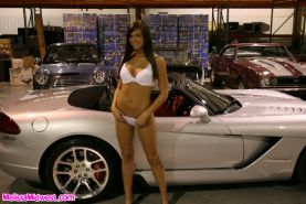Melissa Midwest and SweetAdri posing next to some cool cars
