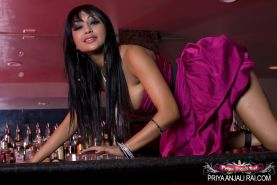 Hot and sexy Priya Anjali Rai climbs up on the counter and shows off her big boo