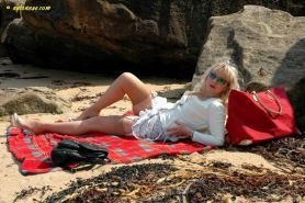 Blonde amateur milf in nylons on the beach