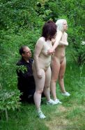 Outdoor spanking training camp of two whipped female slaves