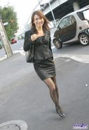 Japanese woman in sexy black pantyhose and a dress